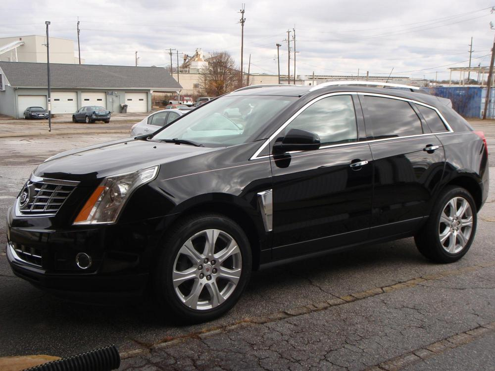 2014 BLACK /BLACK Cadillac SRX Performance Collection FWD (3GYFNCE36ES) with an 3.6L V6 DOHC 24V FFV engine, 6-Speed Automatic transmission, located at 2812 White Horse Road, Greenville, SC, 29611, (864) 269-1711, 34.808655, -82.434776 - Photo #0