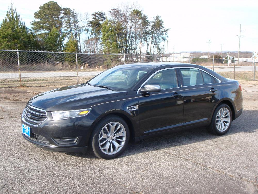 2015 BLACK /BLACK Ford Taurus Limited FWD (1FAHP2F80FG) with an 3.5L V6 DOHC 24V engine, 6-Speed Automatic transmission, located at 2812 White Horse Road, Greenville, SC, 29611, (864) 269-1711, 34.808655, -82.434776 - Photo #0
